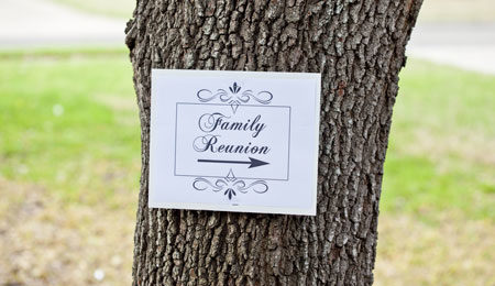 Sign pointing to where the family reunion party is