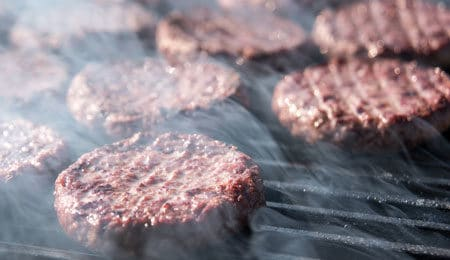 grilled burgers at a company picnic